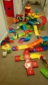 Toot toot garage, car carrier and lots of cars and smart tracks, and the double trailer train