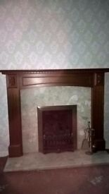 Fireplace with wooden surround and marble insert