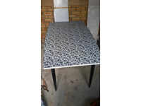 Dining or kitchen table in black and white people design retro 60s 70s
