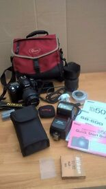 Nikon D50 camera with 3 lenses and accessories