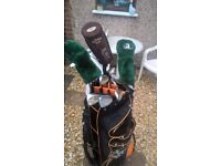 full set of golf clubs, driver,5 wood,3 wood all irons, new golf bag and Dunlop waterproofs size XL