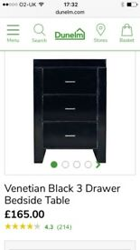 Black mirrored glass bedside cabinet