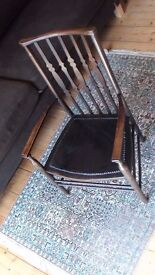 Lovely dark stain chair with arms