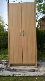 Ex-display Oak Effect Single Wardrobe.
