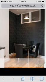 Round black glass dining table and 4 chairs