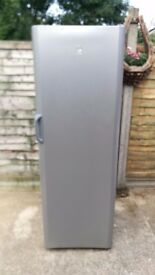 Tall, clean Indesit fridge with no freezer