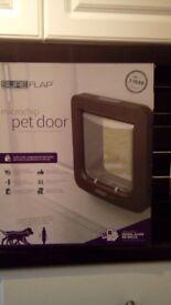 Pet Door- Microchip. Unused & in original box. SureFlap brand. Colour brown.