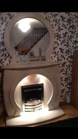 Marble keyhole / horse shoe shape fireplace and matching mirror