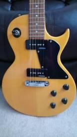 Vintage les paul copy electric guitar in gold colour