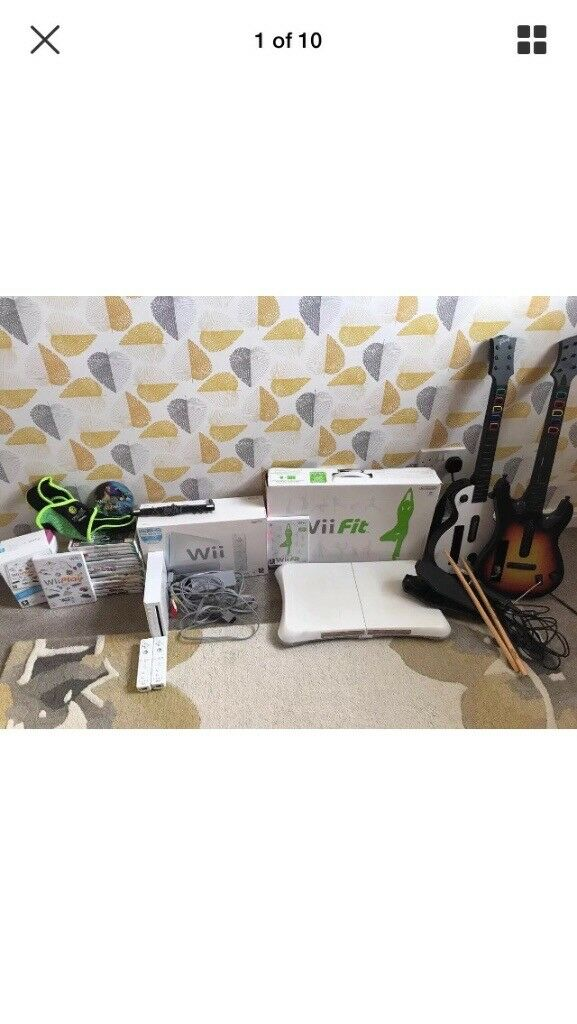 NintendoWii console bundle- includes console, 2 controllers, numchuck, wii fit and guitar hero band