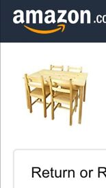 Brand new table and 4 chairs in box!!