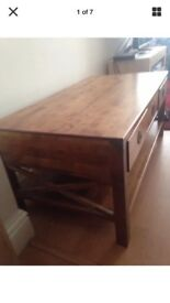 LAURA ASHLEY COFFEE TABLE..solid wood.. honey colour,has 3 drawers
