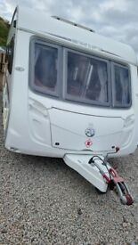 Swift Charisma 555 fixed bed full size awning