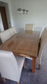 Solid oak dining table and chairs, T.V cabinet and nest of tables