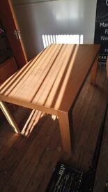 Dining table and four chairs. Heavy wood