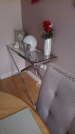 lovely console table in good condition, has been well looked after glass and chrome