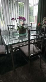 Glass dinning table, 4 chairs. Length 120cm width 70cm. Collection only £50