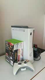 Xbox 360 with wireless controller and 7 games