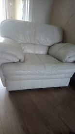 2 DFS Cream Leather Arm Chairs (used) 5 years old