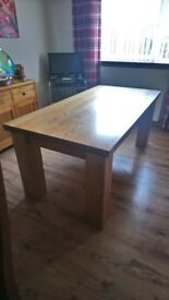 Solid chunky oak dining table