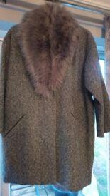 Coat with fake fur collar