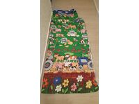 Kids sleeping bag with farm design. Has built-in pillow case Would fit a toddler bed.