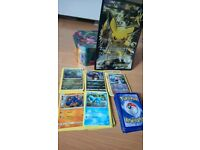 Pokemon cards, tin and giant card