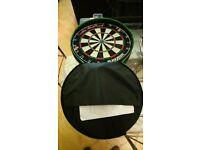 Dart board on tour in case with darts