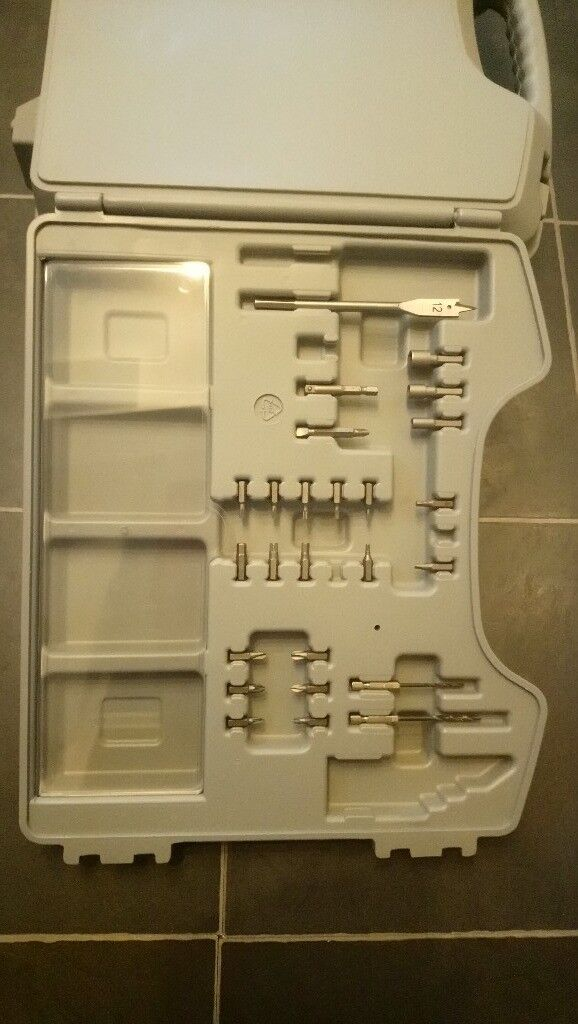 Cordless electric drill 14-4 volt with case and some bits as shown