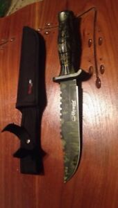Green and black olympia combat knife with sheath