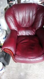 Burgundy settee and one arm chair