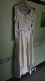 Designer satin wedding dress used once. Size 10