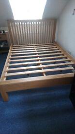 Solid Oak King size bed frame.