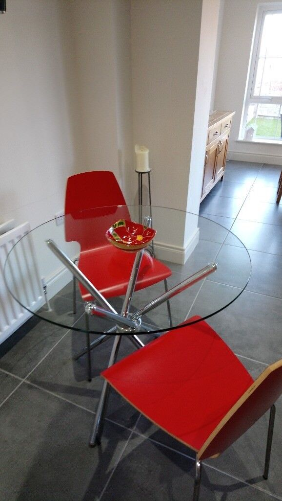 Round Glass Table 90 Cm With Two Red Chairs