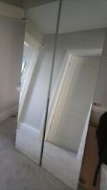 A Pair of Ikea Pax Vikedal mirror fronted wardrobe doors with hinges.
