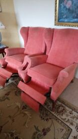Two free salmon pink recliner chairs