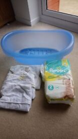 Baby bath, towels and nappies