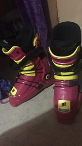 Pink and yellow ski boots