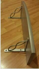 Shelf with metal brackets