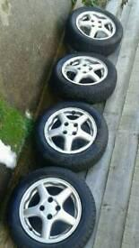 "4 x 14"" Honda alloys"