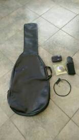 Electric guitar case, tuner, 10 gauge strings, strap and pedal join lead.