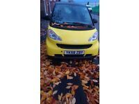 Smart car in yellow and black