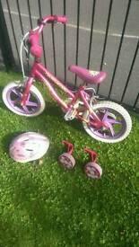 Used girls bike with stabilisers and helmet.