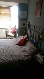 large furnished double room in friendly, sunny house. Bills included in rent.