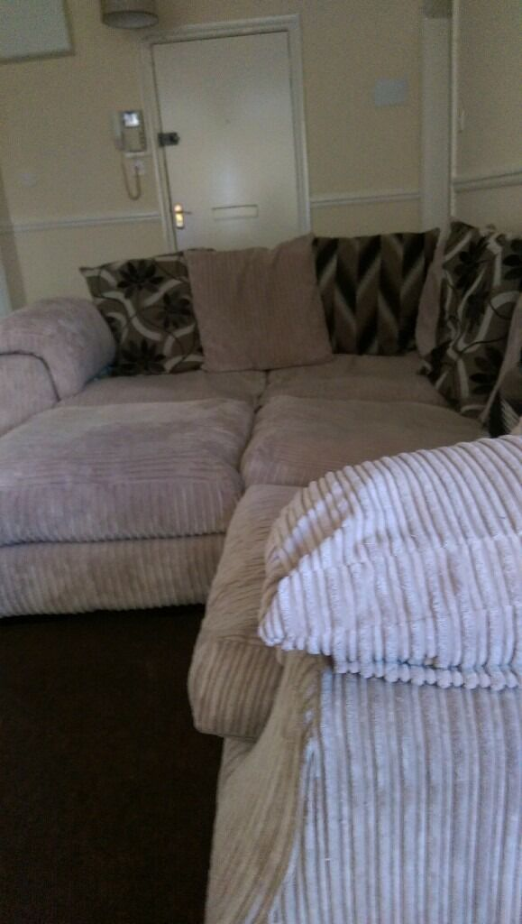 corner sofa with pouffein Southampton, HampshireGumtree - Corner sofa in stone colour, comes with 8 scatter cushions and a pouffe, Very clean and great condition. Sofa can also come apart as two. Selling as moving house. Collection only Weston