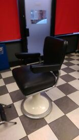 """Barber Chairs. Five matching 1940's La Reine classic """"Restocrat"""" chairs."""
