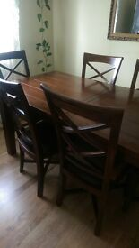Solid wood extendable dinning table + 6 chairs