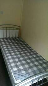 Brand new single bed frame and orthapedic mattress.
