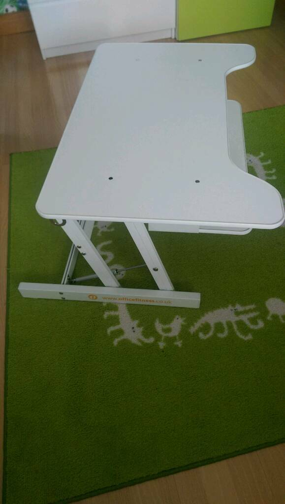 Deskriser. Height adjustable desk.