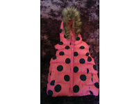 girls pink gilet with navy spots age 3-4 yrs with faux fur hood fleece lining